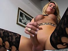 Fishnet suited TS Camille jerks off solo