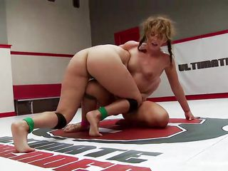 lesbian fans fight it out in the wrestling ring