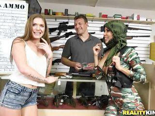 showing their guns in a gun shop for green
