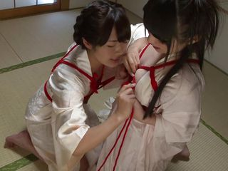 kimono-clad nymphos receive some female fondle