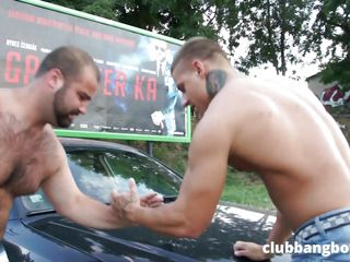 hunks have an arm wrestling match