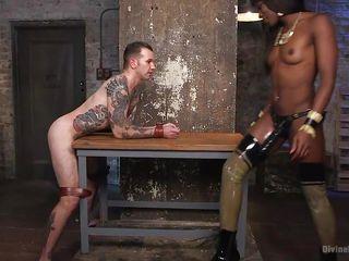 ebony mistress rails her white slave's ass with a big strap on
