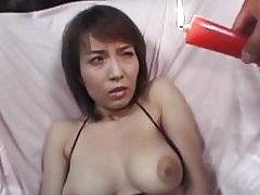 Busty Japanese chick in bikini is covered in hot candle wax