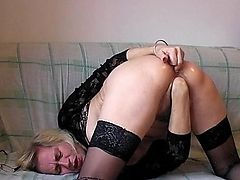 Mature in nylons fists her shaggy cunt